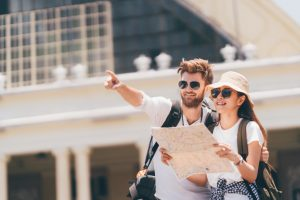 Couple traveling with map
