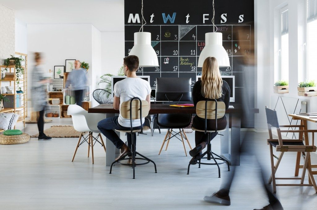 Modern coworking space with blackboard