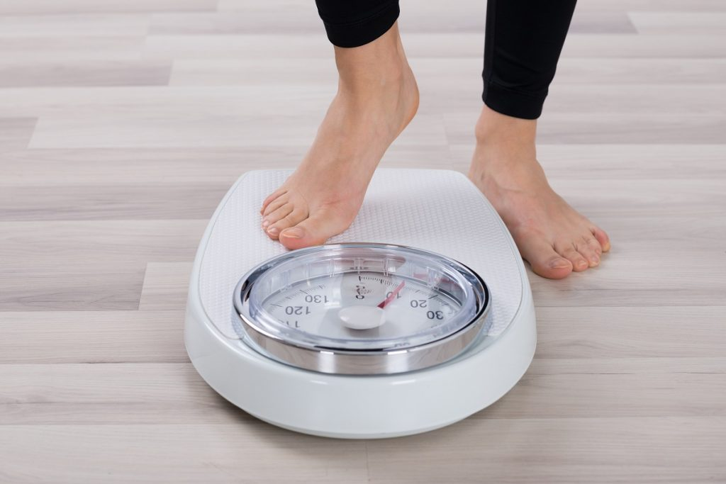 Woman weighing scale