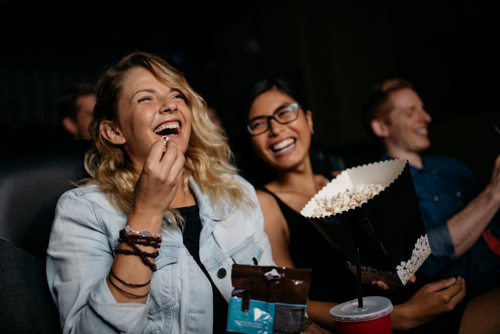 Woman watching a movie with a friend