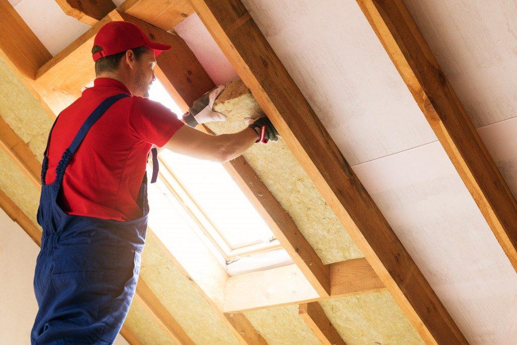 man designing his ceiling