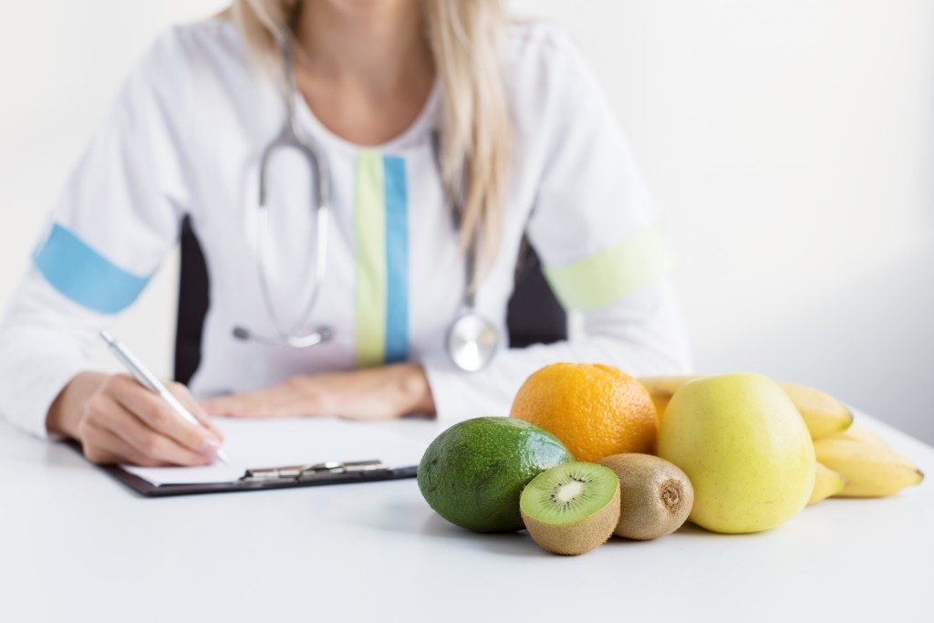 fruits in front of doctor