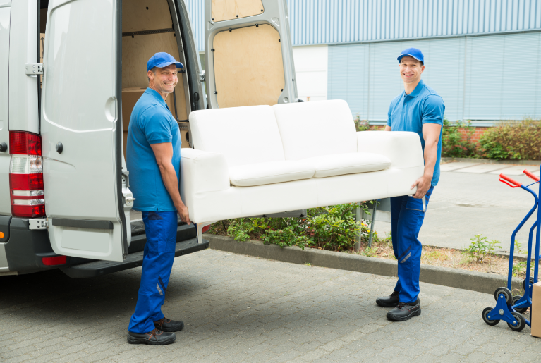 Professional movers carrying a sofa