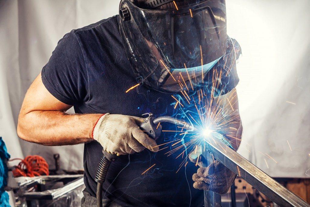 Man welding on a metal