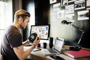 Freelance photographer checking his shots