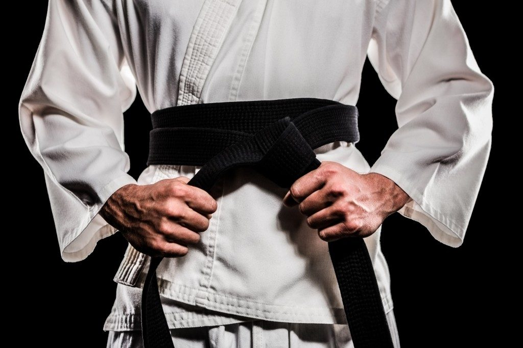 Fighter tightening his karate belt