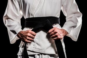 Fighter tightening his karate belt