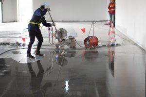 workers applying epoxy coating on the floor