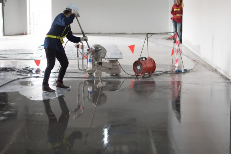 workers applying epoxy coating on the floor