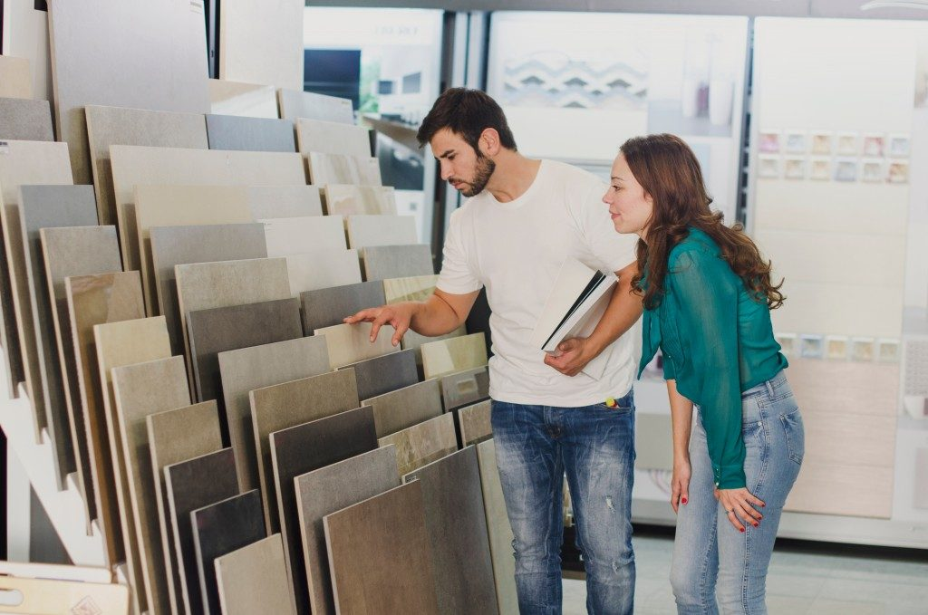 couple looking at floor tile designs