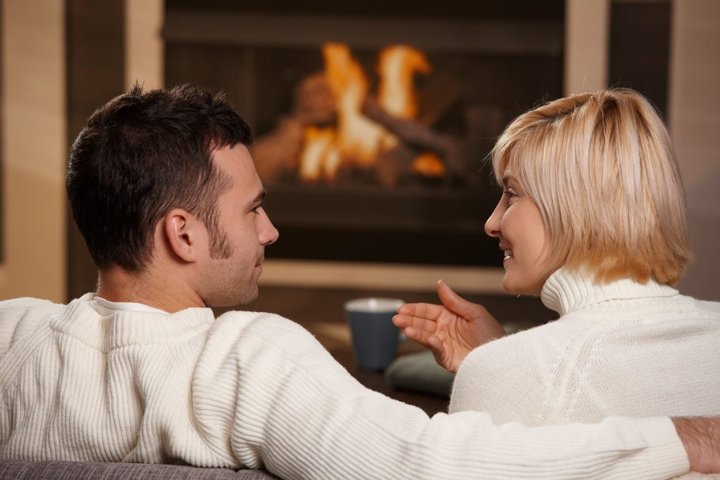 couple by the fireplace