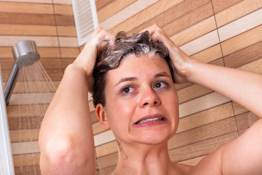 Woman having a cold shower