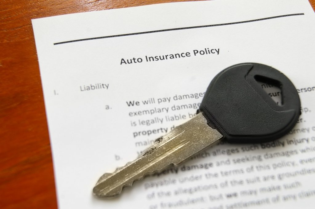 Insurance policy and a key