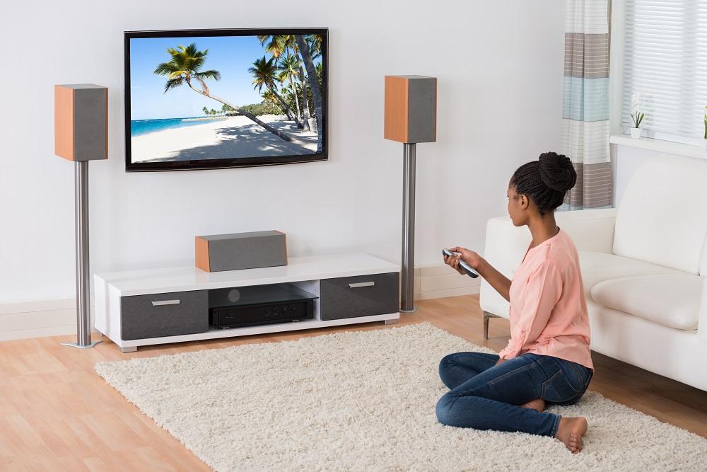 woman at home watching tv
