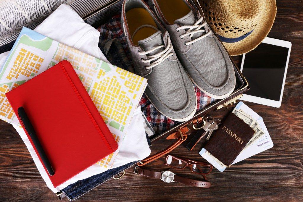 suitcase with travel essentials