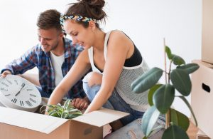 couple putting their things in boxes