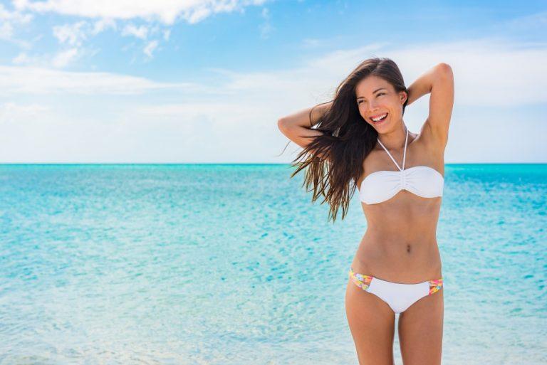 woman at the beach wearing white bikini