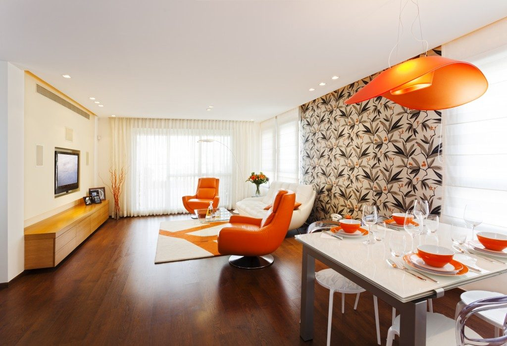 Modern living room with orange touch