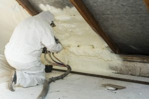 Worker insulating the attic