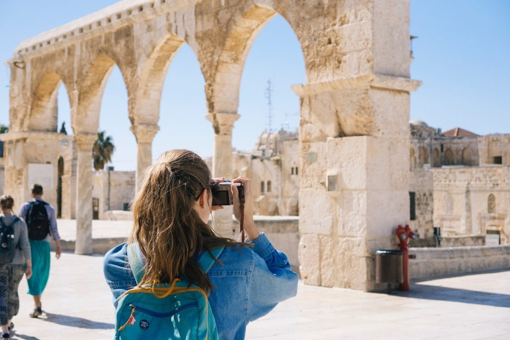traveler taking photograph of a ruin