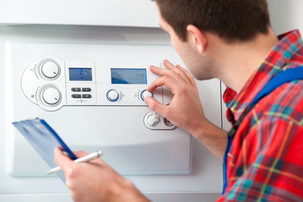 man adjusting home heating system