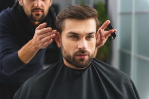 Man at the barbershop getting his hair done