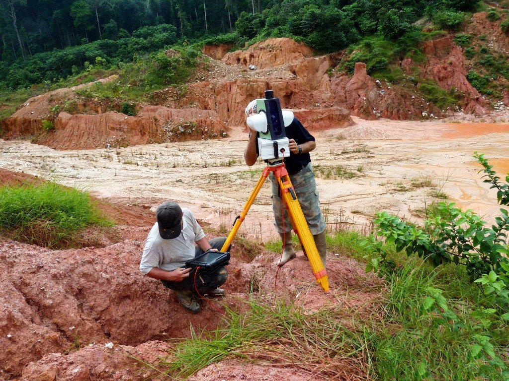 man setting up for land surveying