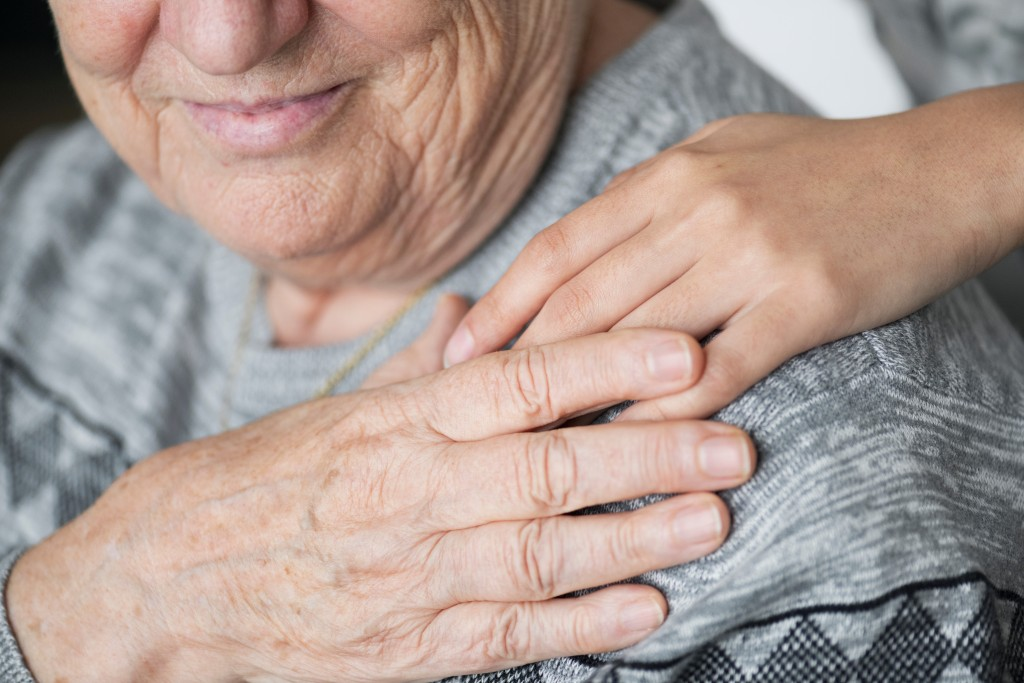 Old person being cared for