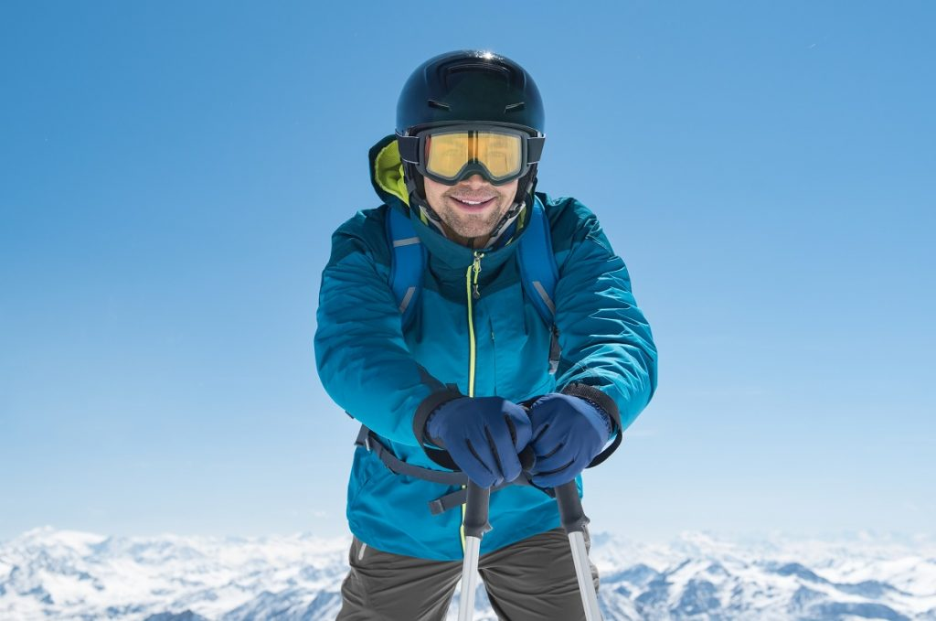 Man smiling in winter clothes
