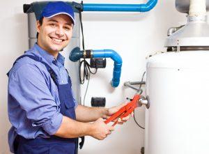 man fixing the heater