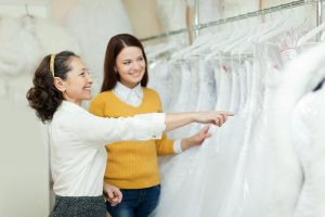bride to be choosing a wedding gown