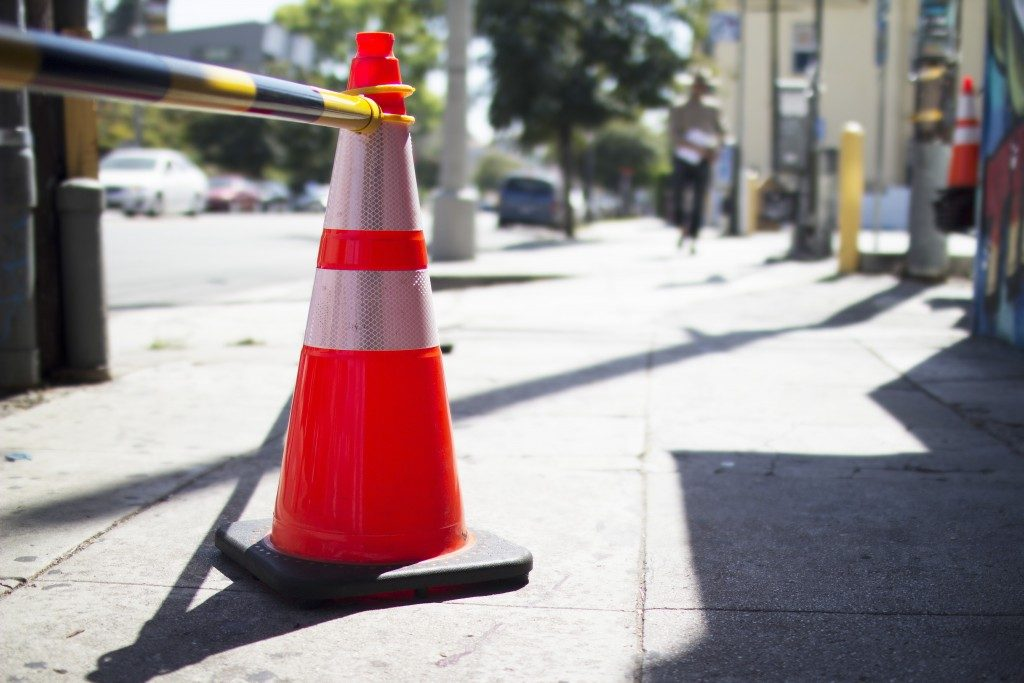 pavement with orange cone