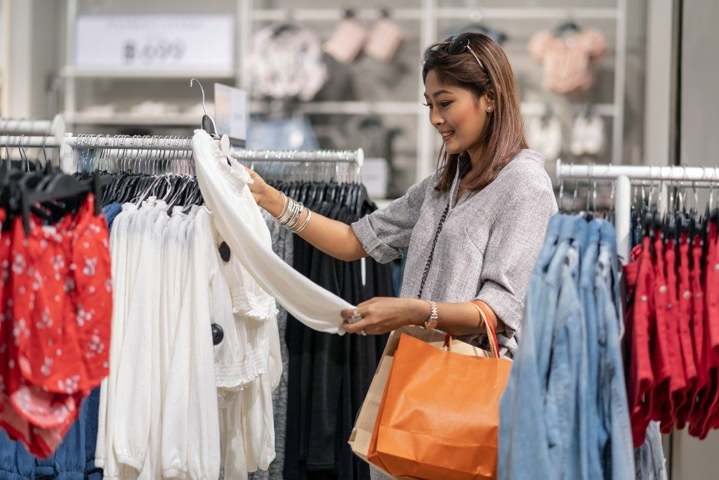 Female looking at blouse in store
