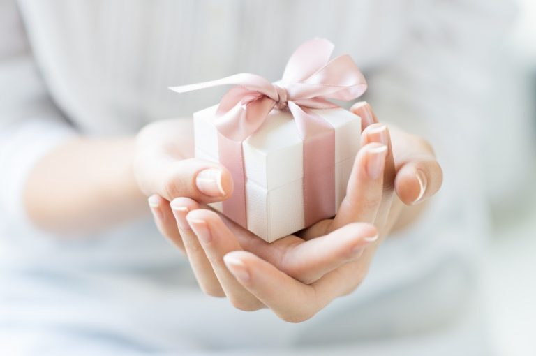 person holding a small gift box