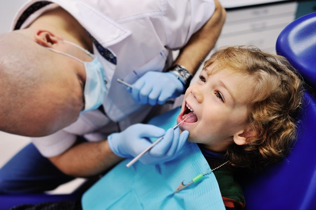 Kid getting dental procedure