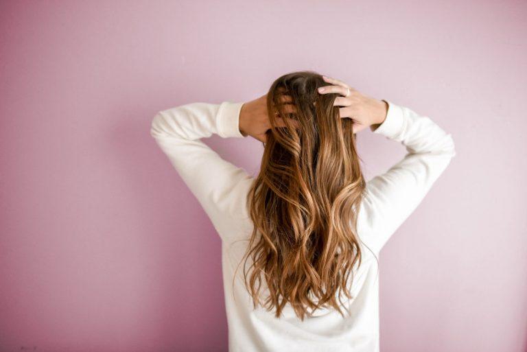 Woman touching her long hair