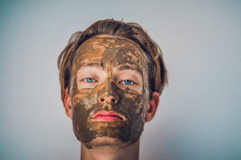 Man wearing clay mask