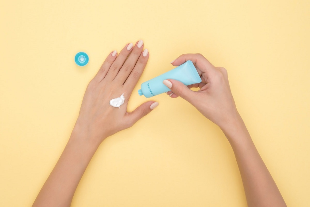 Applying cream to hand