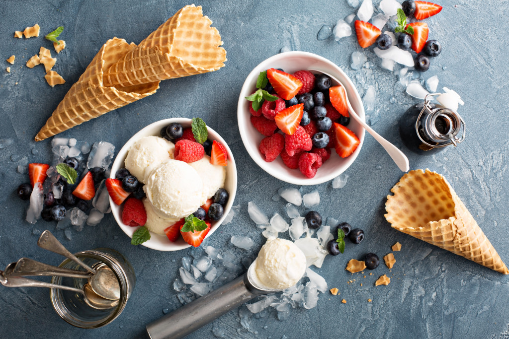 Ice cream with fruits and cone