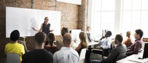 woman presenting in a meeting