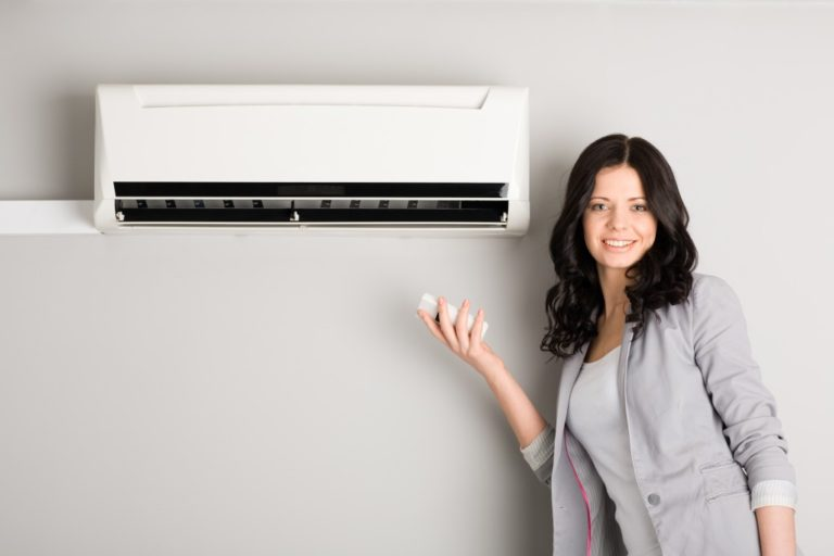woman by the ac unit