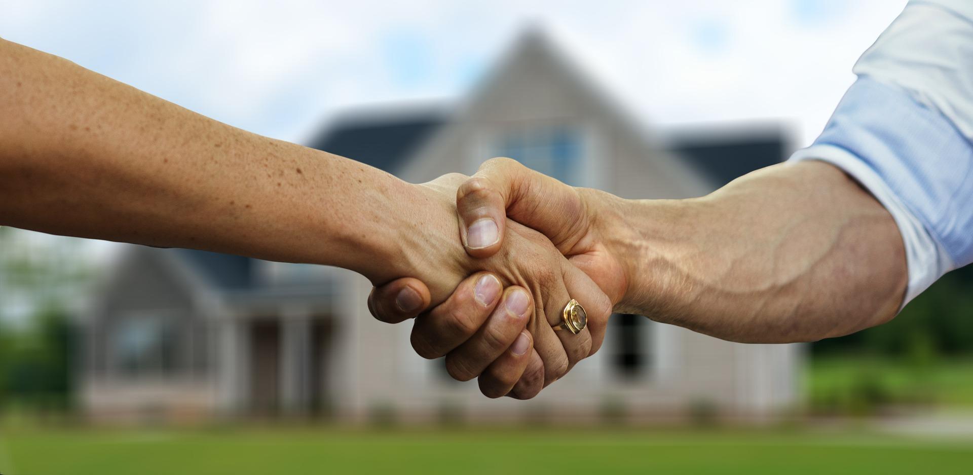 two-people-handshaking