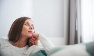 woman thinking beside a window
