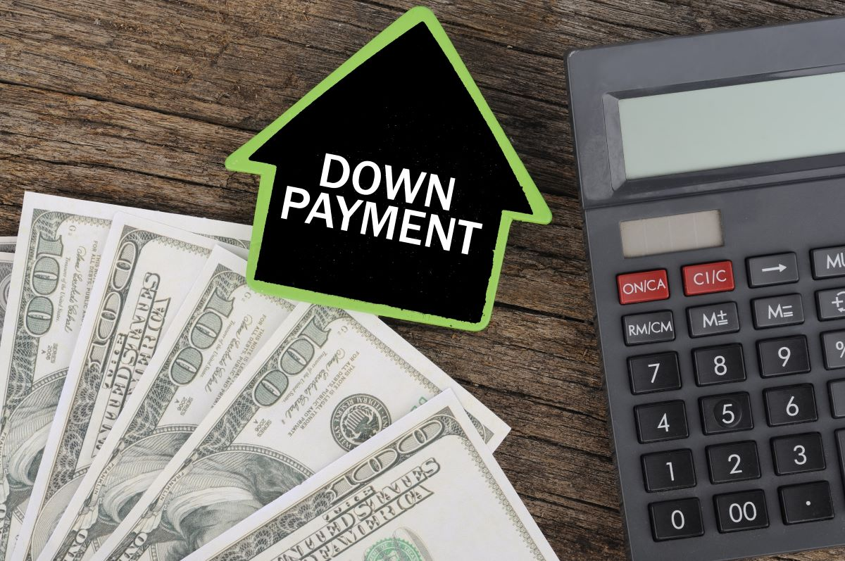 DOWN PAYMENT Word on House with Calculator and Dollars On Wood Background, Costing and Budget Concept