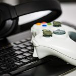 game controller, keyboard and headphones