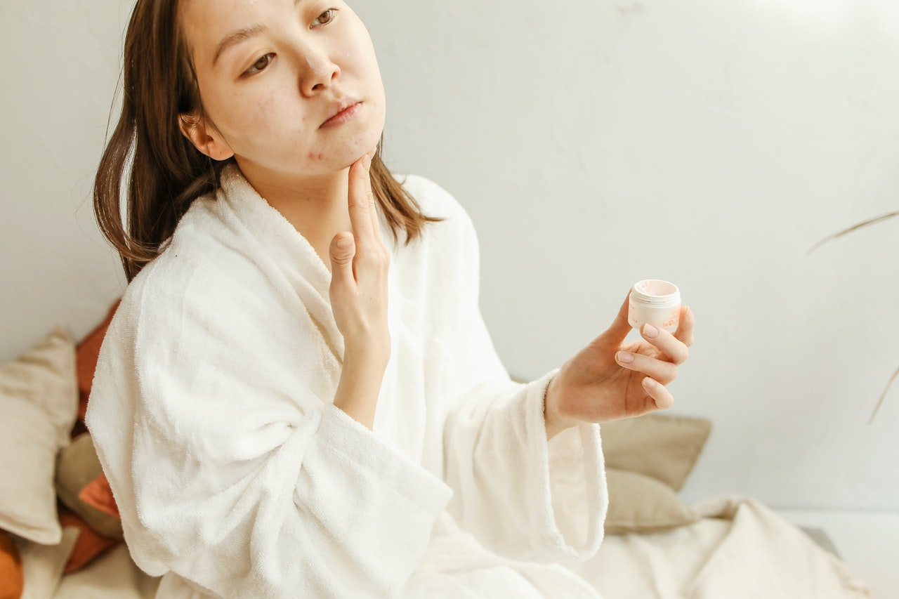 Girl treating her fungal acne