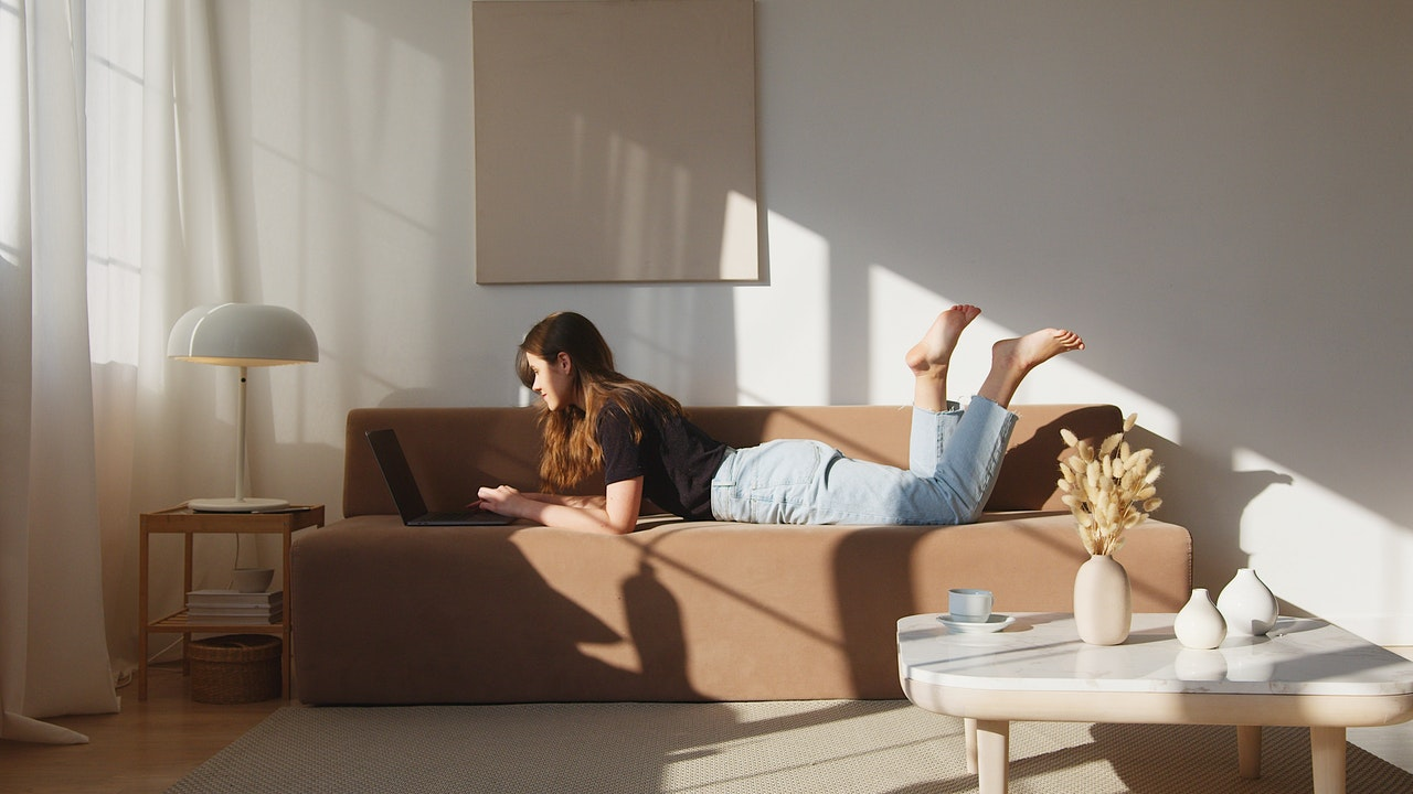 woman laying down on a couch