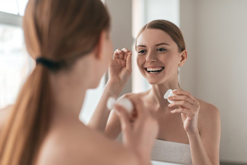 woman placing makeup
