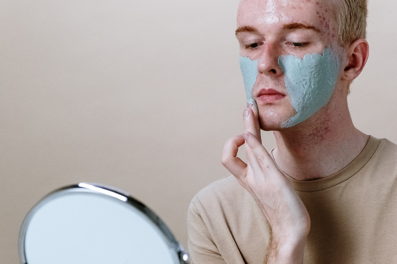 man applying a cream to his face