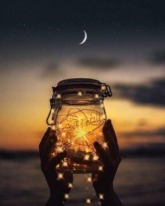 holding up a mason jar
